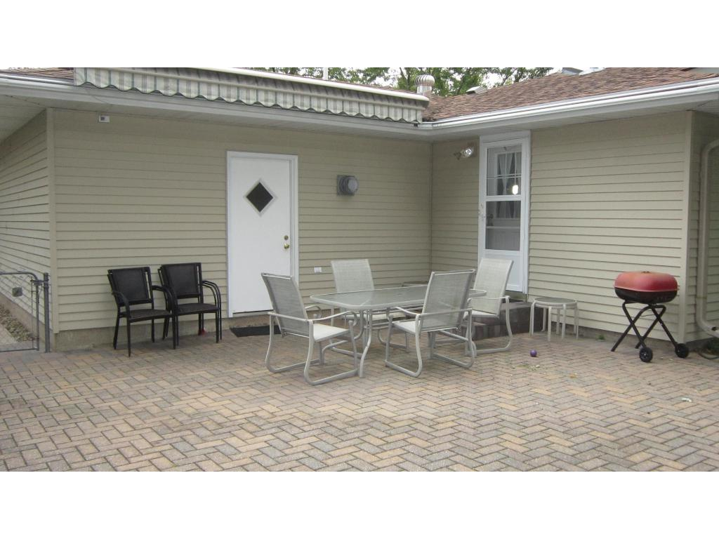 Huge backyard brick paver patio with canopy pulled in.