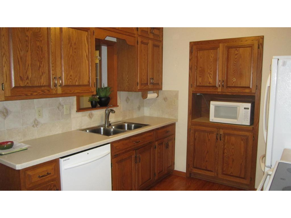 Galley kitchen with extra deep sink and beautiful appliances