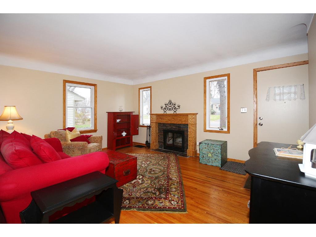You'll love all the natural light and the wood burning fireplace in the living room!