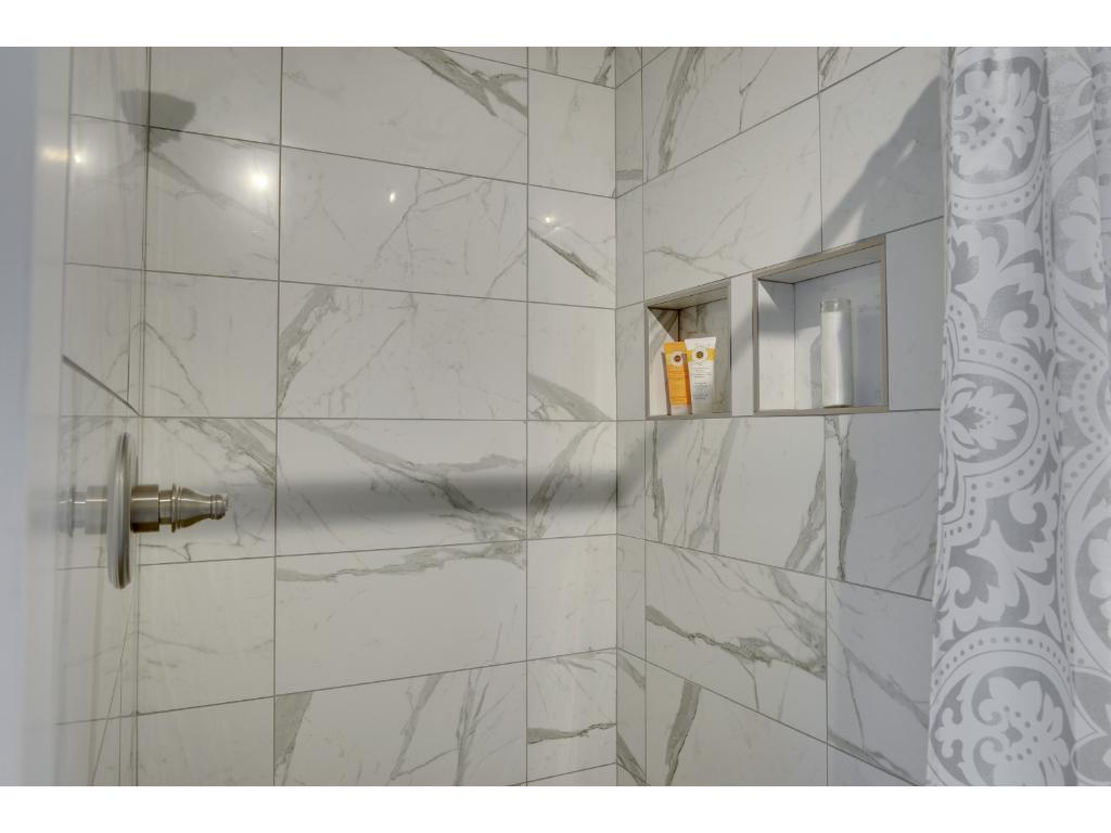 As you can see this is High End Custom Tile on the Walls and a completely Custom Shower Floor using Flat Pebble Stones.