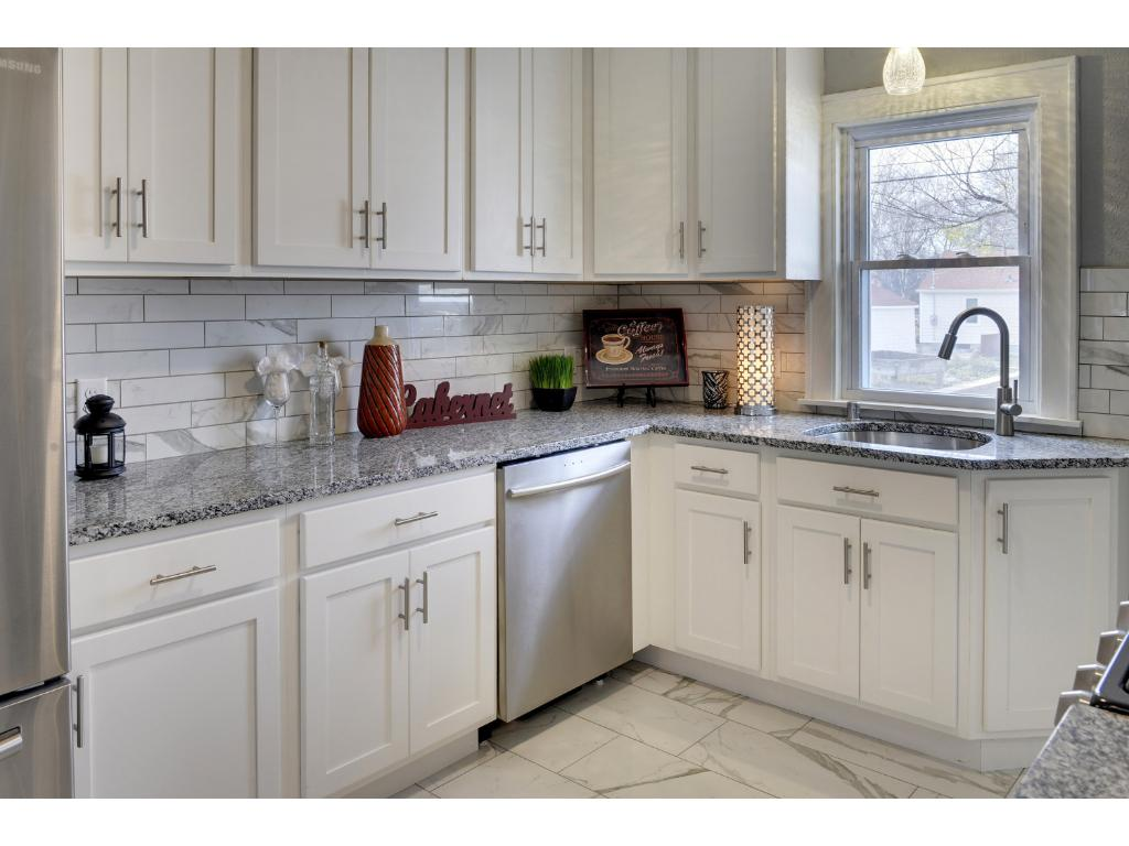Lots of Cabinet & Counter Top Space with Gorgeous Granite and Custom Tile Backsplash.