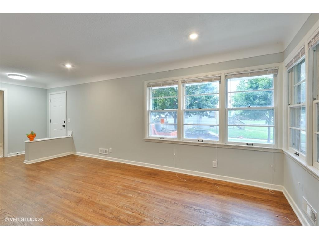 A front door view with coat closet off of entry makes living easy with plenty of storage throughout the home.