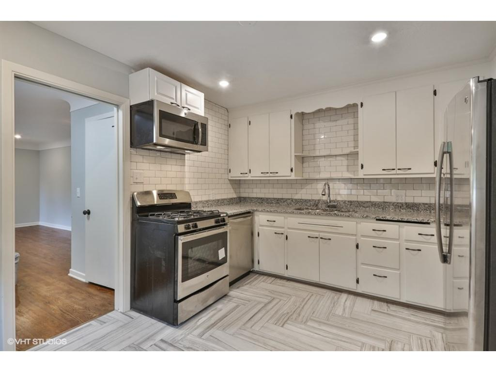 Sparkling, Brand New Kitchen shines offering family entertaining with eat-in kitchen and lots of windows. Easy access to walkway mudroom and garage. High end tile, Granite counters and stainless appliances.