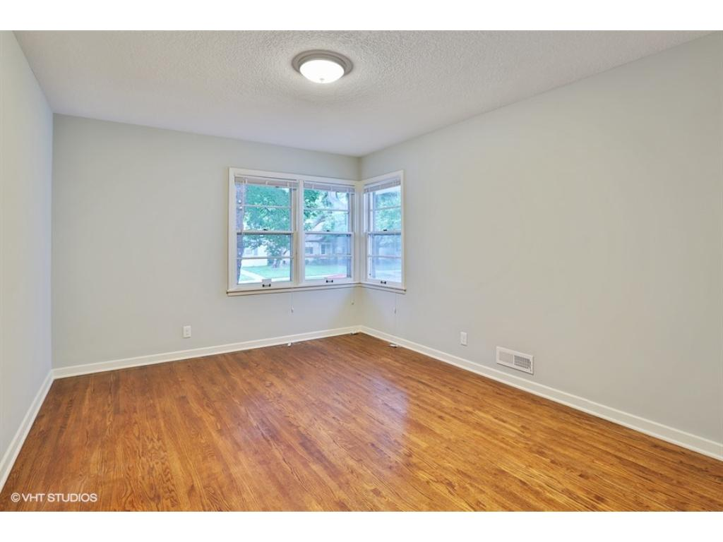 One of 3 large bedrooms! Front corner bedroom with nice closets and refinished floors.