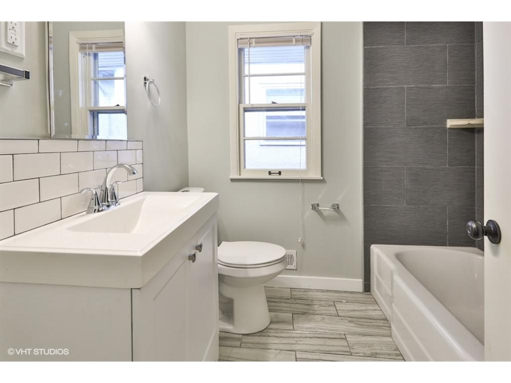 Gorgeous modern elements complete this new main floor full bathroom.