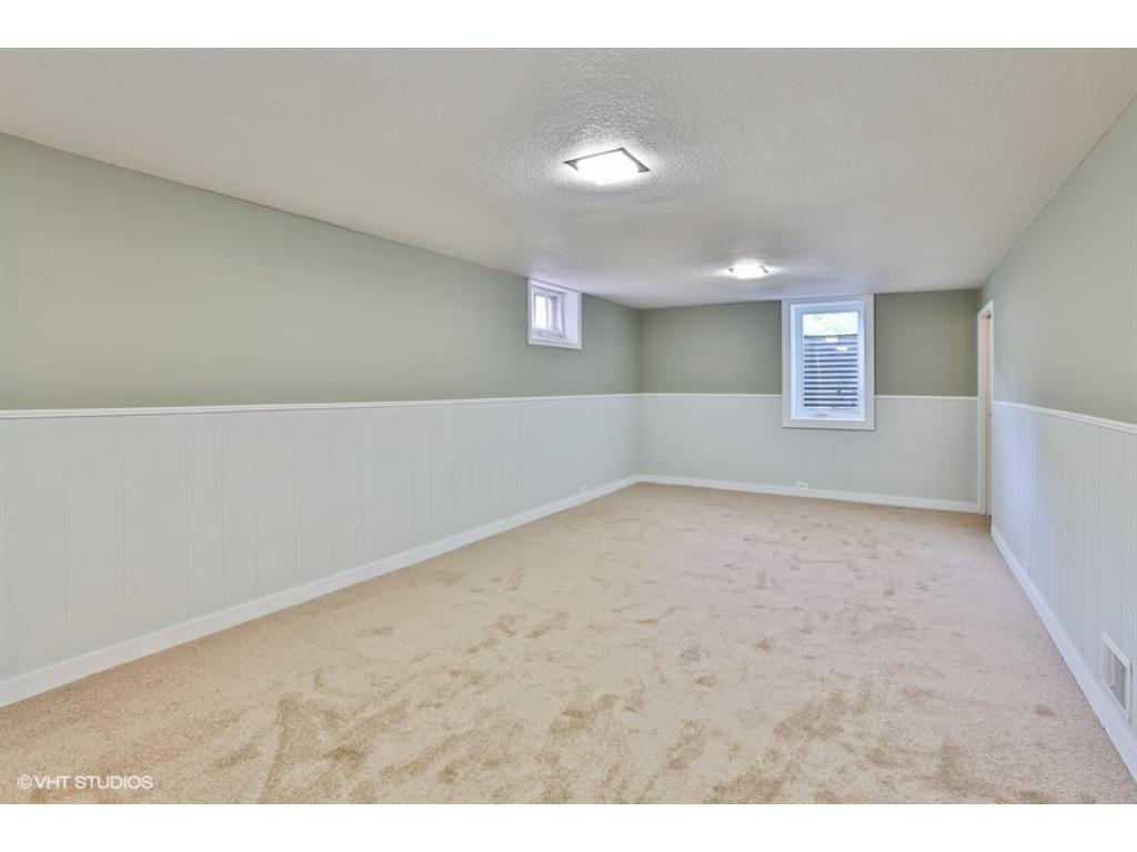 Lower level family room or 3rd bedroom offers tons of light new carpet wainscoting and great closet. Located off of a dry enormous laundry/utility room and along with separate bathroom this basement rocks with a workshop/studio!
