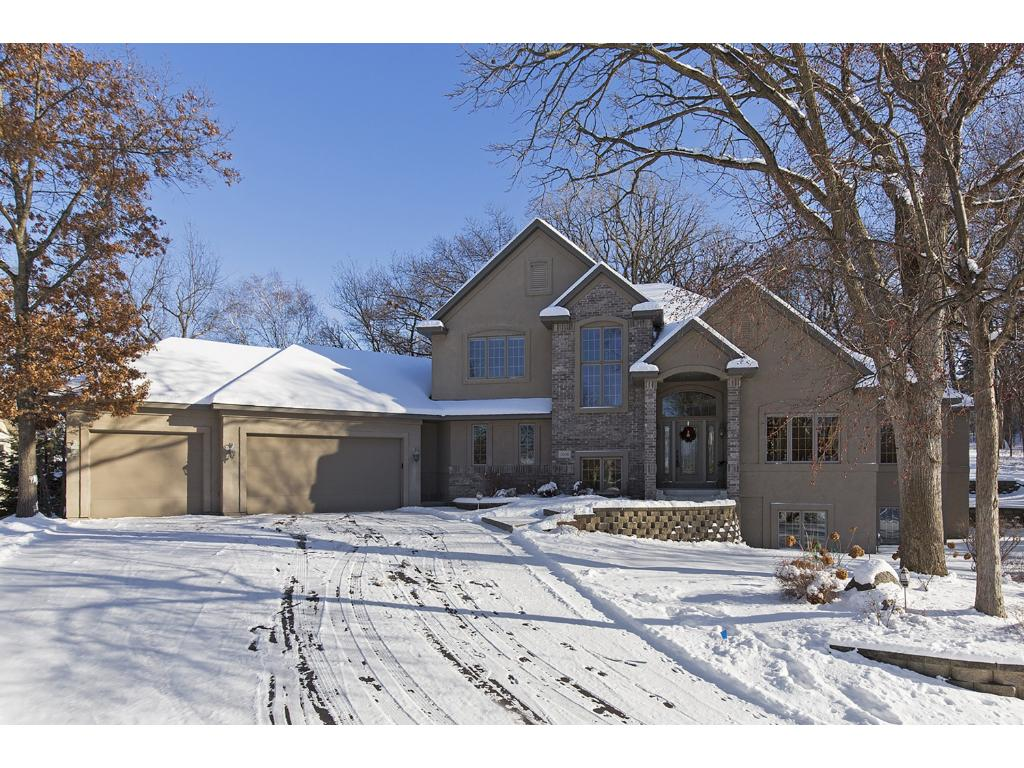 Escape to this custom-built Four Bedroom, Four Bath masterpiece, nestled in a premium North Eagan neighborhood.