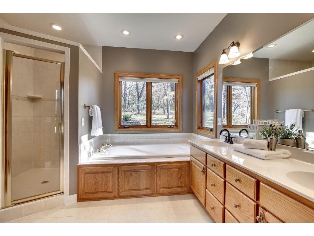 The lavish Full Bath offers in-floor heat, a whirlpool tub and separate shower.