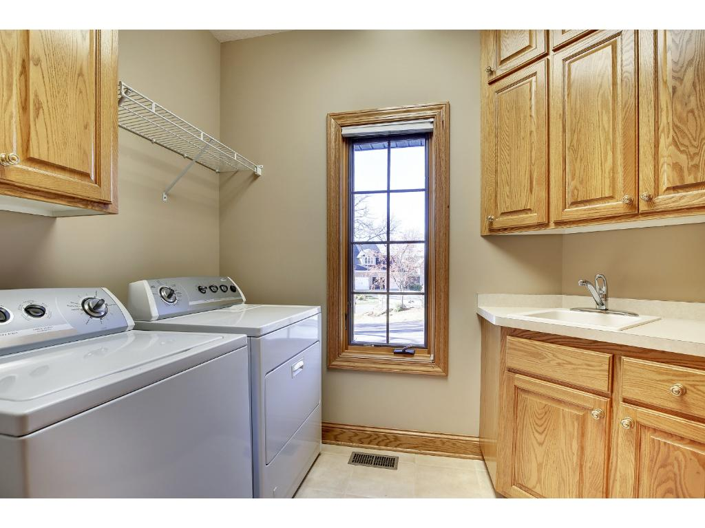 The main floor Laundry Room is a real step-saver! Also find a Half Bath and Mudroom.