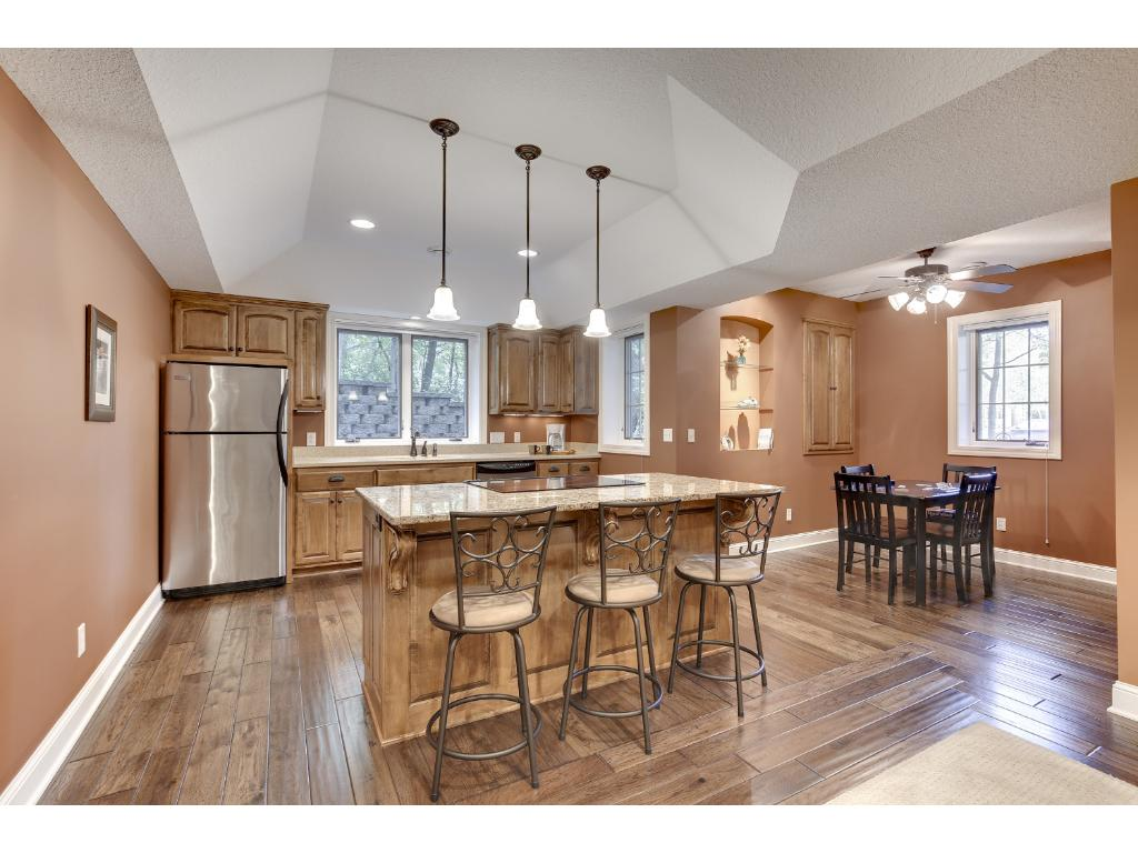 The second Kitchen boasts stainless steel appliances and granite counter tops, and a Dining Room steps away.