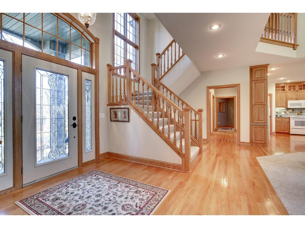 The sun-splashed Foyer greets you with hardwood floors and bright windows.