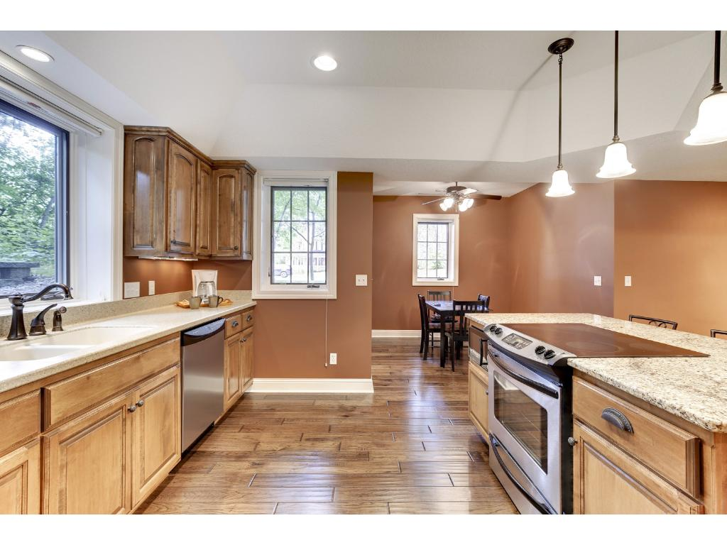 The Kitchen is accented with pendant lighting, abundant cabinetry, and a breakfast bar with counter seating.