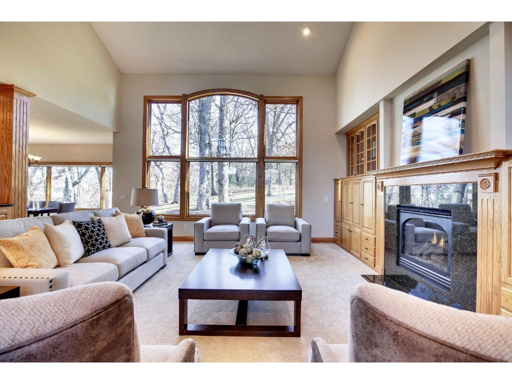 Step into the spectacular Great Room, accented with a soaring vaulted ceiling.