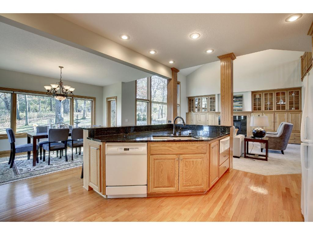 The well-designed Kitchen will delight. Enjoy abundant cabinetry, sensible work space, a breakfast bar with counter seating, and a walk-in Pantry.