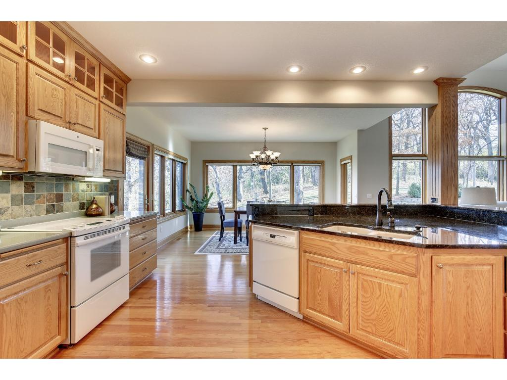 The Kitchen offers hardwood floors, warming drawer, and granite counter top.