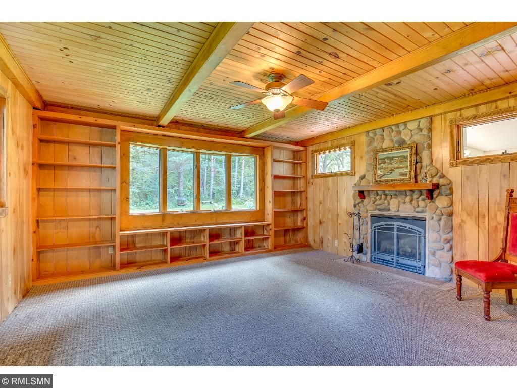 Family room is paneled with another gas fireplace.