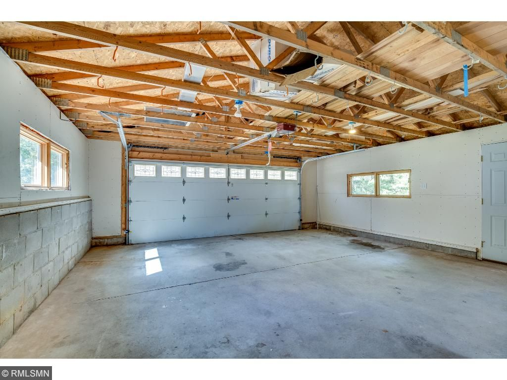 Two car garage is spacious with upper storage potential