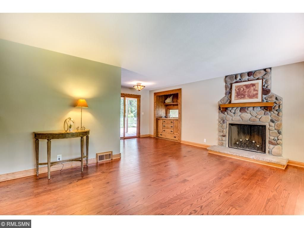 Main floor has beautiful newer hardwood floors, fresh neutral paint, and gorgeous stone fireplace