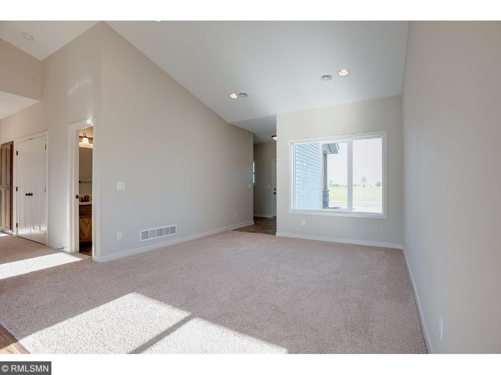 Living room with vaulted ceilings.Photo: 370 Ladd Ln.