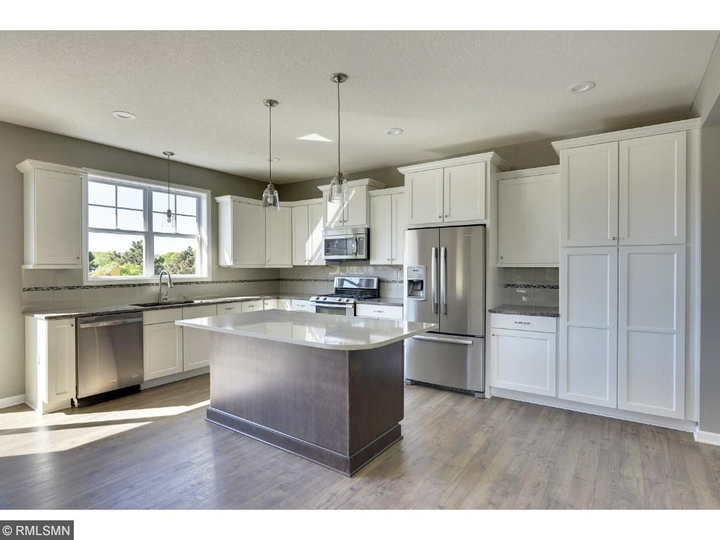 You'll love the large window over the sink & sliding glass door - lots of natural light. Visit on-site to tour the model. Pleasant Ridge. Summit Hill., St. Paul.