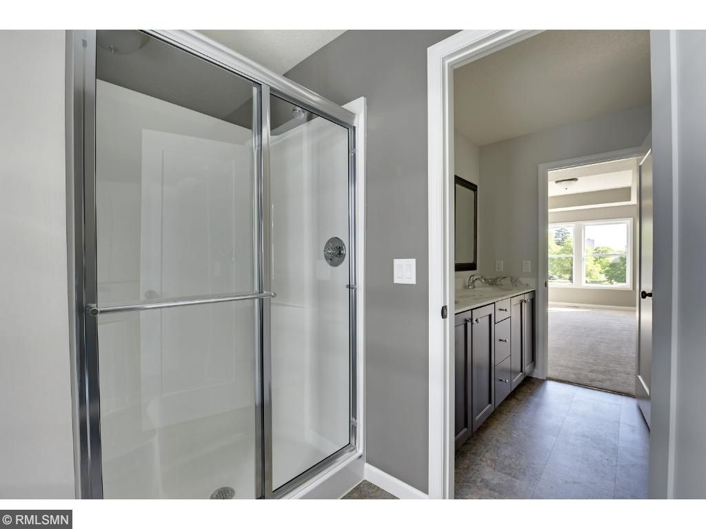 This floor plan features the convenient main-floor master suite complete with walk-in closet and full bathroom. Visit on-site to tour the model. Pleasant Ridge. Summit Hill., St. Paul.
