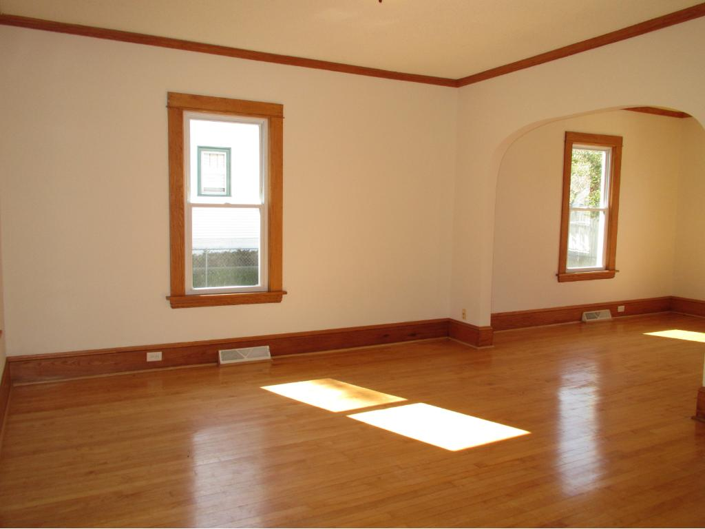 Living room with sparkling hardwood floors.