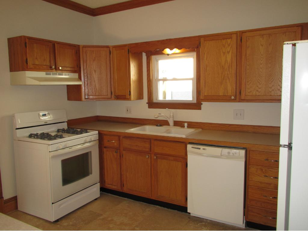 Updated kitchen features brand new travertine floors, plenty of cabinet space, and a ceiling fan.