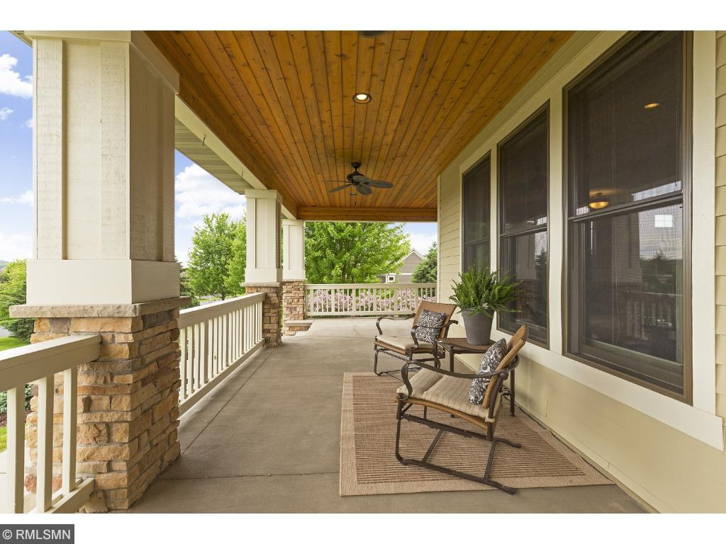 The ever popular front porch has golf course views of this stunning neighborhood.