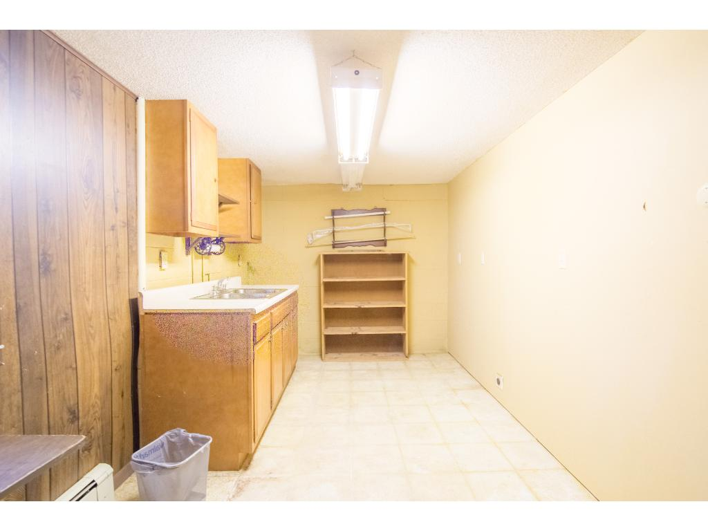 Dated kitchen in lower level