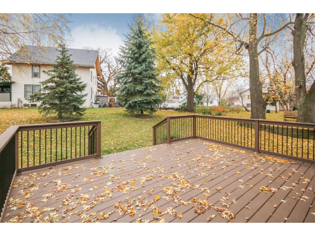Relax on the deck and enjoy the wonderful views of the mature trees and backyard.