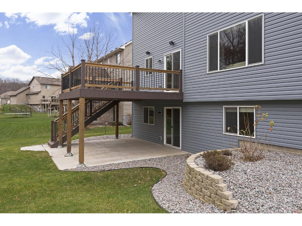 Nicely landscaped back yard makes the deck even more comfortable while you're entertaining friends and family.