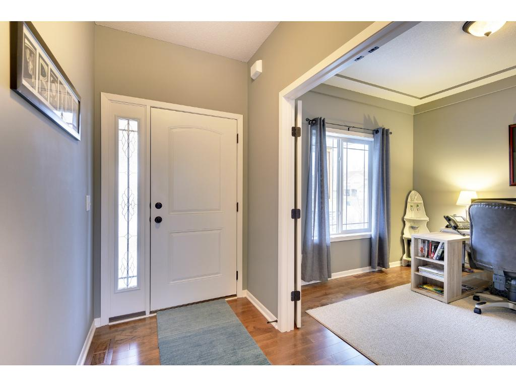 A welcoming entry with solid cherry hardwood floors.