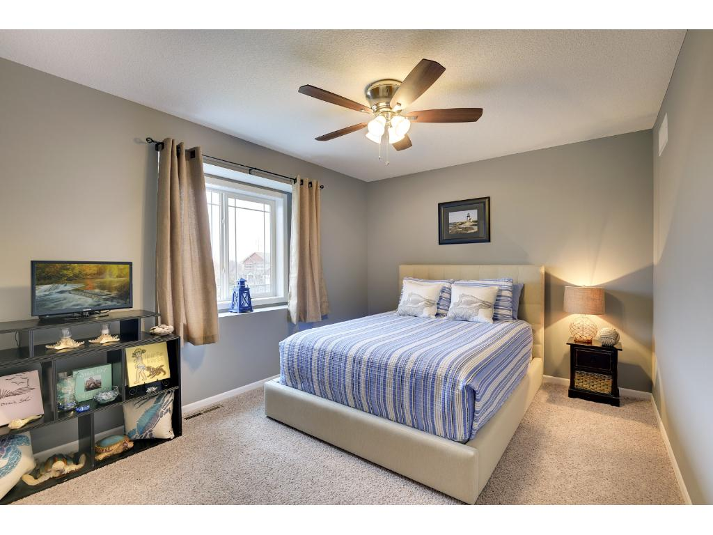 A bright, spacious comfortable guest room.