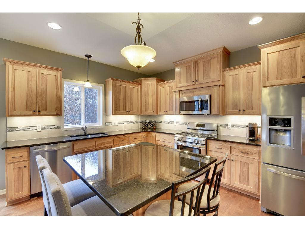 Beautiful cabinets with enameled mill work.  Stainless steel appliances.