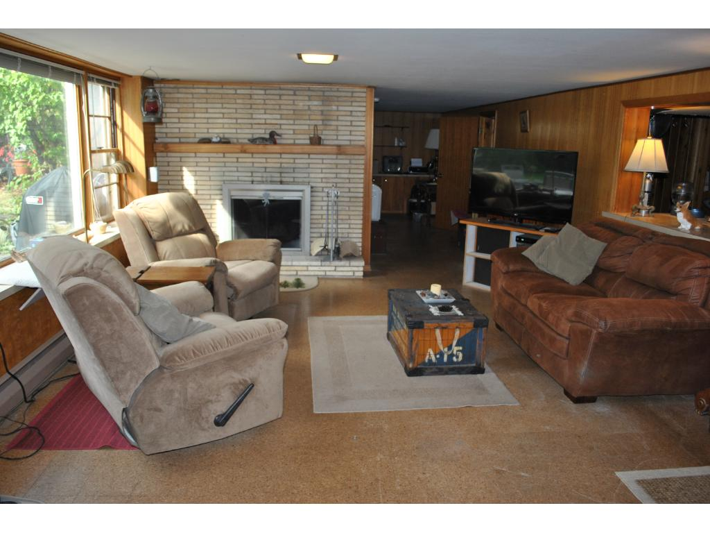 The afternoon sun pours in the lower level walkout.  Also has a functional wood burning fireplace.  There is a 4th non conforming bedroom that needs an egress and also room for a large 5th bedroom.