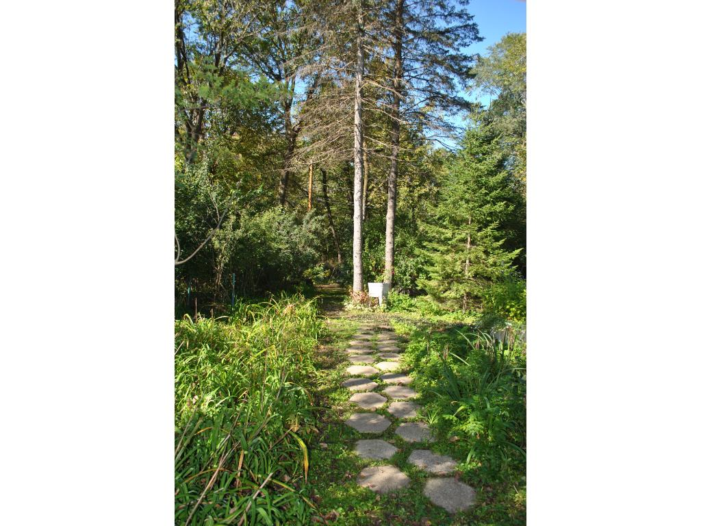 Beautiful established trees on the property bring a peaceful and private setting.