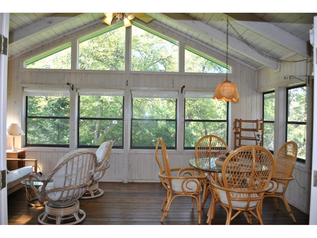 Beautiful 3 season porch off the back with quiet private views of the wooded lot.  Wonderful space to entertain or relax with room for both a table and seating area.