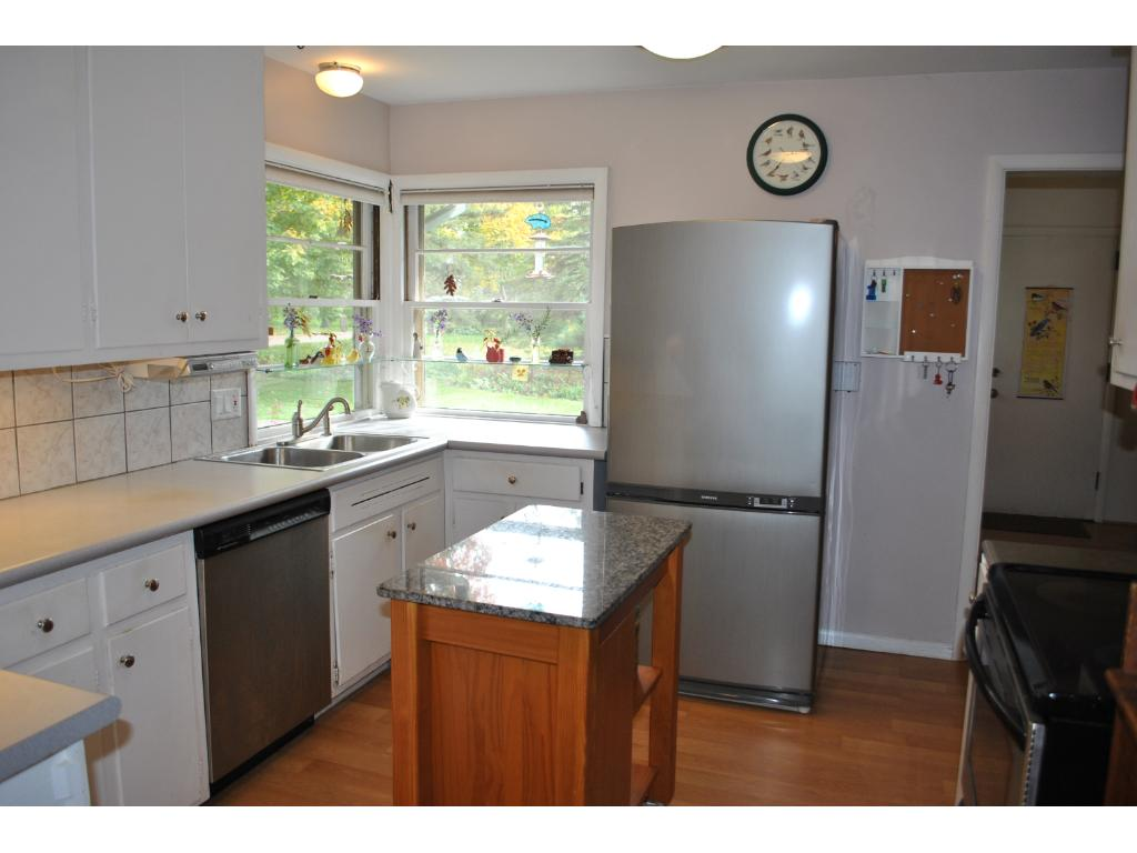 Bright sunny inviting kitchen with updated appliances and a workable layout.