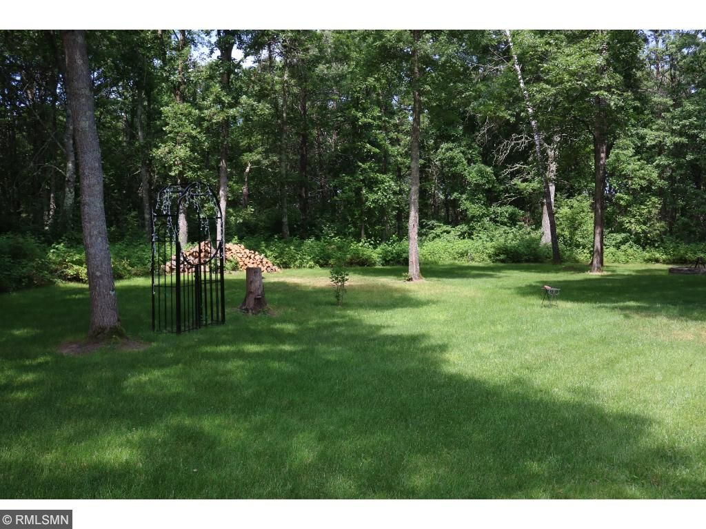 Backyard has mature trees and faces towards the 7 acres.