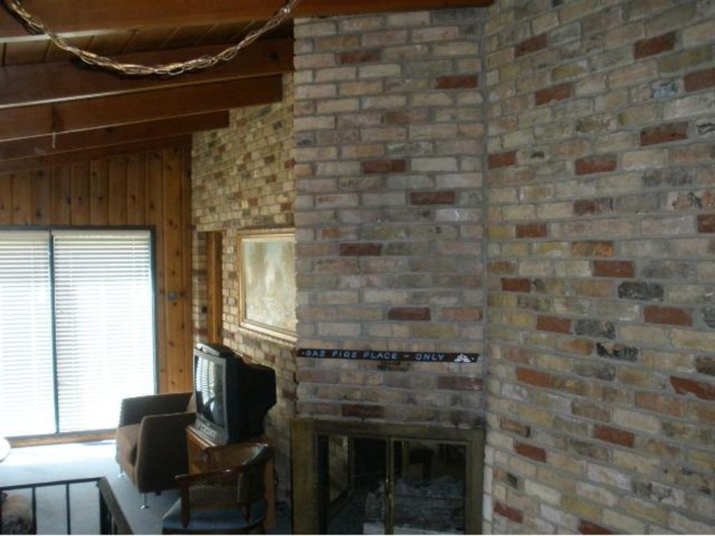 Tiburon clubhouse has beautiful brick fireplace.