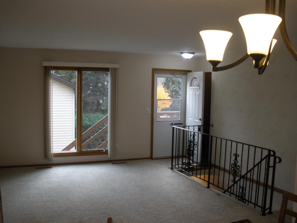 Spacious living room newly painted both walls and ceilings.  New light fixtures.  Newer front doors.