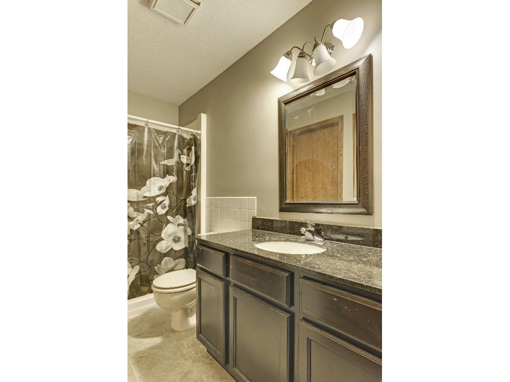 Upper level bathroom with granite vanity top.