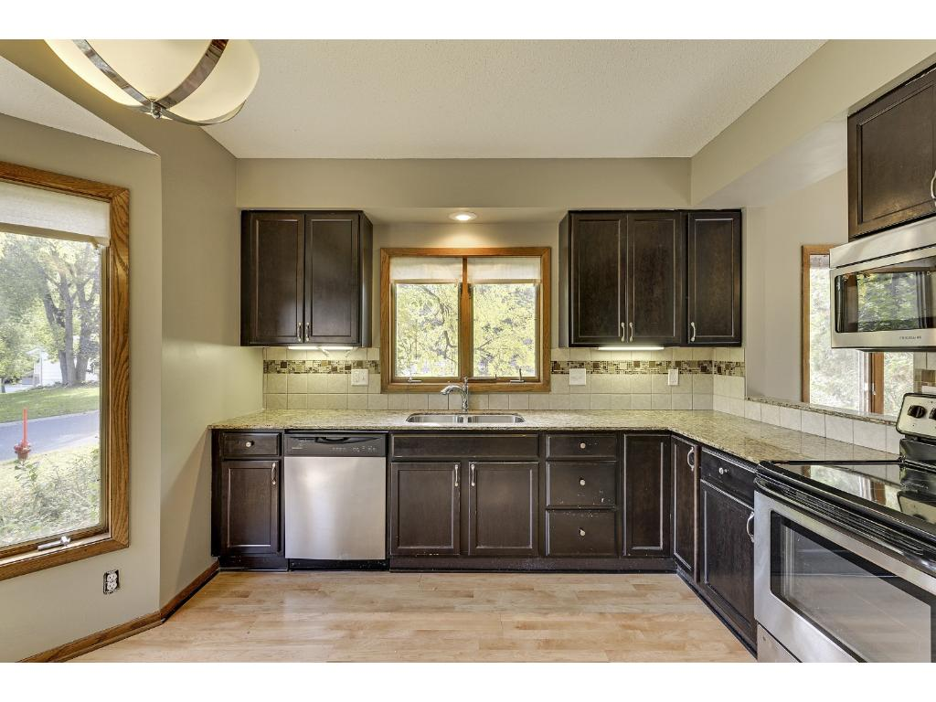 Granite counter tops, under cabinet lighting.    Roomy enough kitchen for dine-in and planning desk.