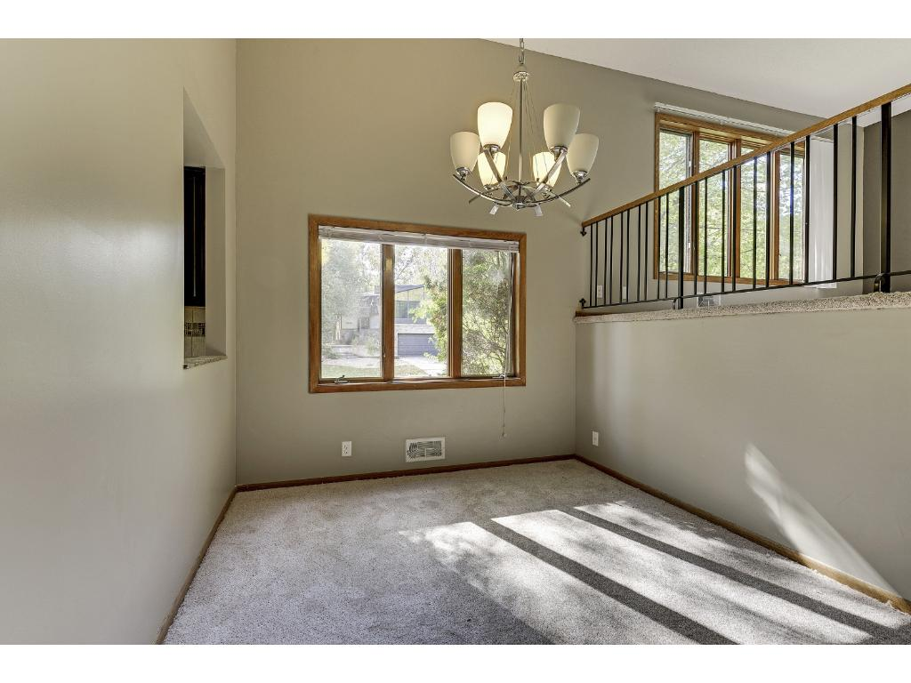 Formal dining area with good natural lighting and openness with overview to living room above.