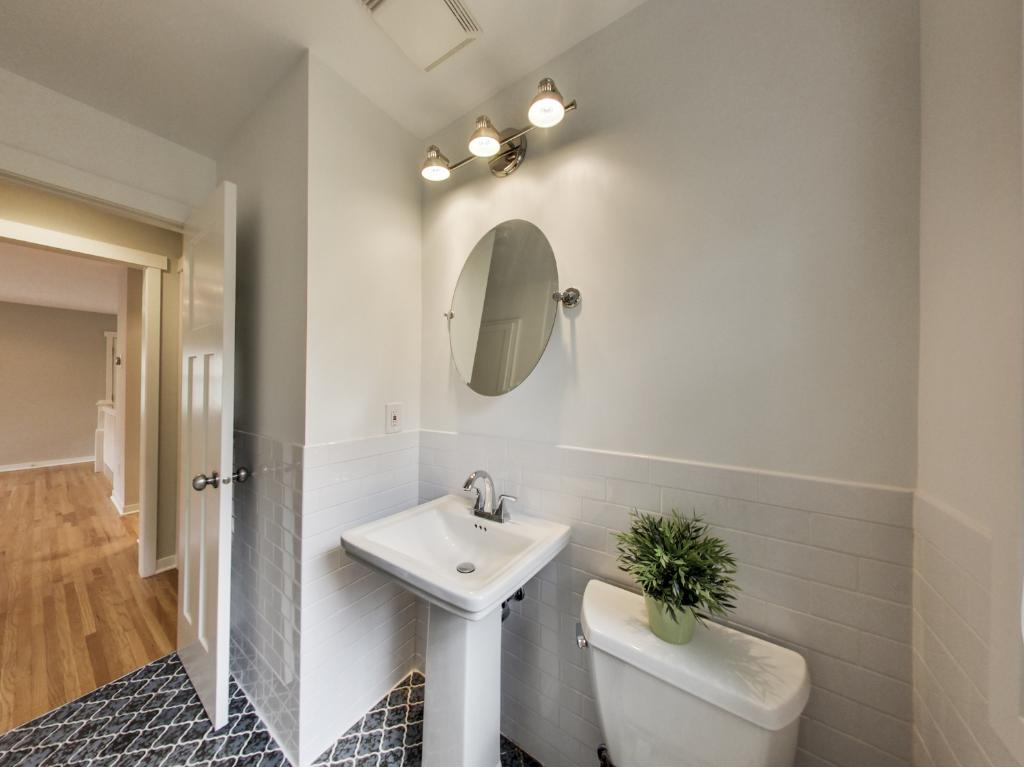 Pedestal sink, vintage tile, ceramic surround.