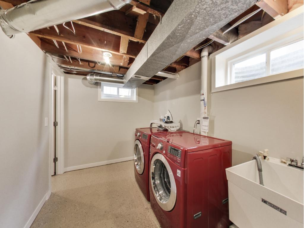 Clean/bright utility room w/ access to wine cellar.