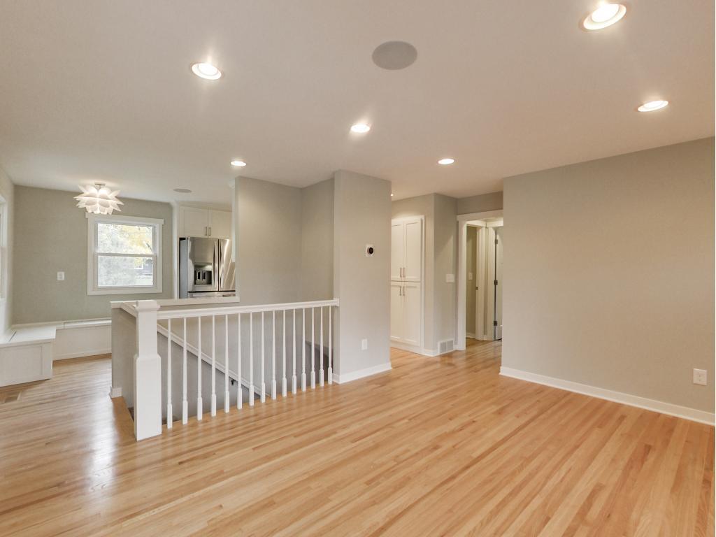 Living room w/ gleaming hardwoods, enameled woodwork.