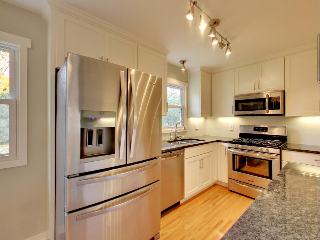 Fabulously functional kitchen w/ granite, custom cabinets and professional grade appliances.