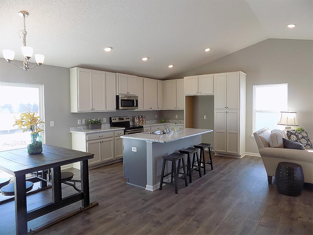 An open floor plan on the main level with three bedrooms upstairs.