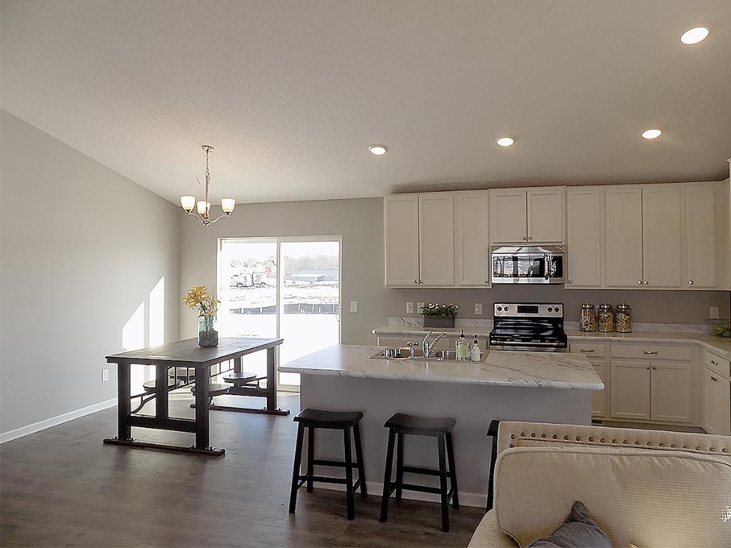 A finished lower level family room adds to the space of this home.